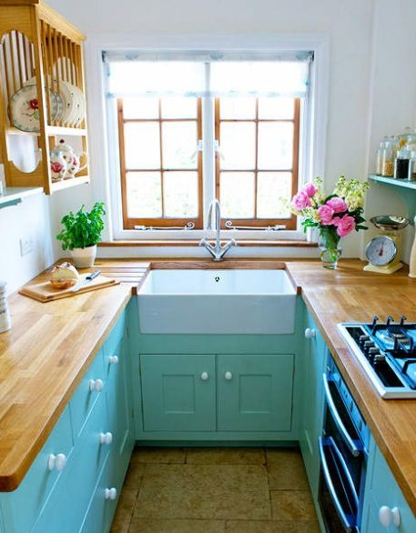 Tiny kitchen with bright cupboards