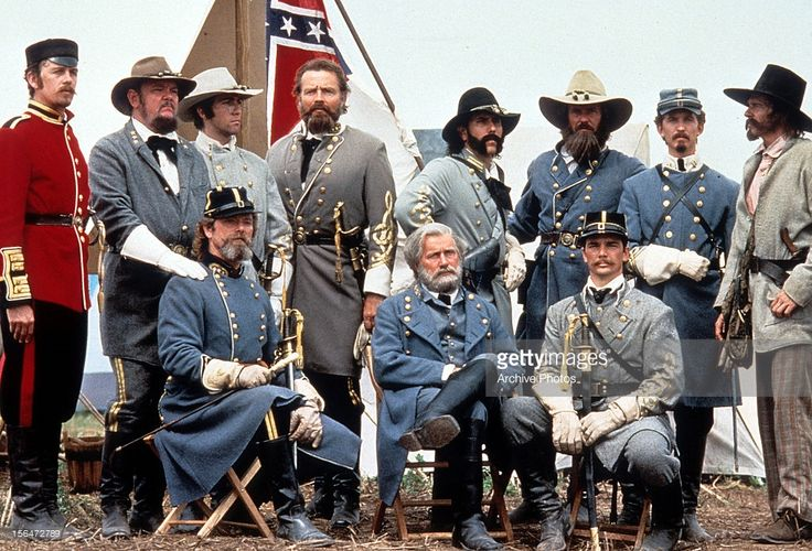 Richard Jordan, Martin Sheen, Tom Berenger, and soldiers pose in a scene from the film 'Gettysburg', 1993.