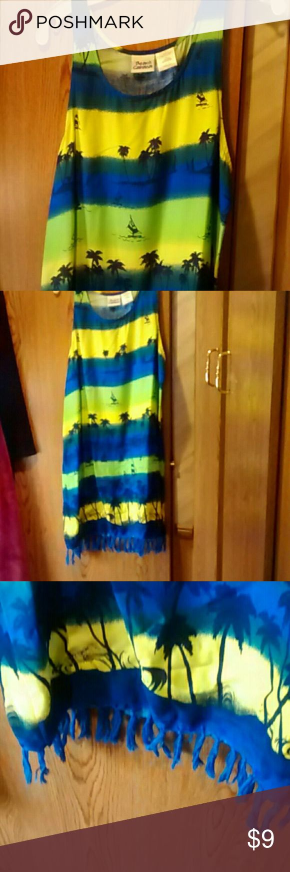 Dress/Swimsuit cover up sz S Gorgeous dress with tropical scene. Tasseled hem. Beach Cabana, size Small. Gently preowned condition. Smoking/pet home. Sprayed with Febreeze and packaged with dryer sheets. Questions and offers welcome. No trades please.  Happy to bundle. Thanks for looking.?? Dresses Mini