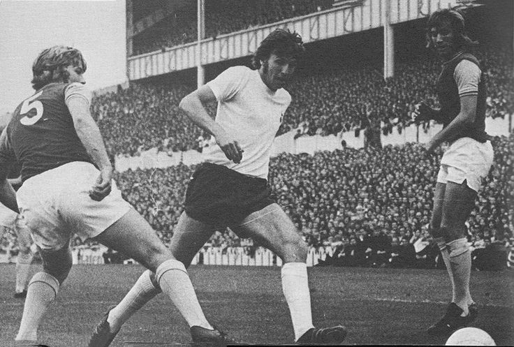 23rd September 1972. Tottenham Hotspur captain Martin Peters finding a gap between former West Ham United team mates Tommy Taylor and Billy Bonds, at White Hart Lane.