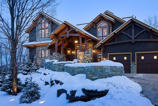 Timber frame home covered in snow