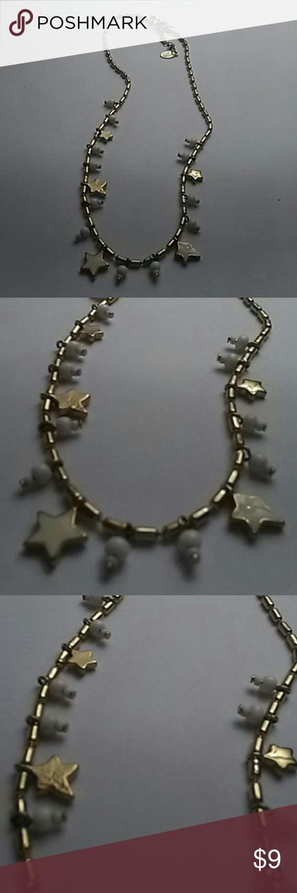 Liz Claiborne Star Charm Necklace Liz Claiborne Star Charm Necklace with Goldtone dangling stars and dangling white beads Liz Claiborne Jewelry Necklaces