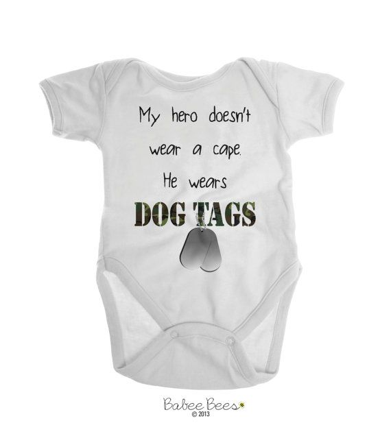 My Hero Doesnt Wear A Cape, He Wears Dog Tags  This army baby clothing makes the perfect gift for an expecting military or army daddy! Gender neutral