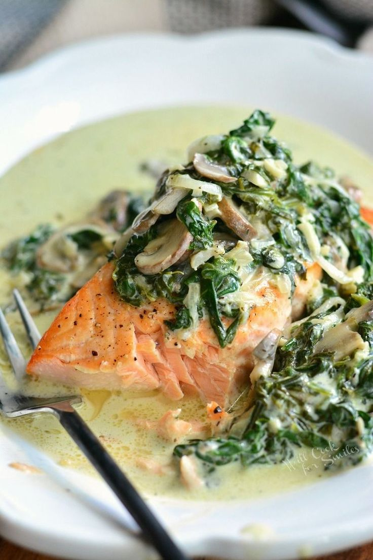Salmon Florentine. Baked salmon and topped with creamy spinach and mushrooms.
