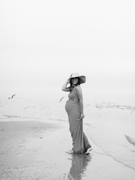 candid type pose for maternity beach session