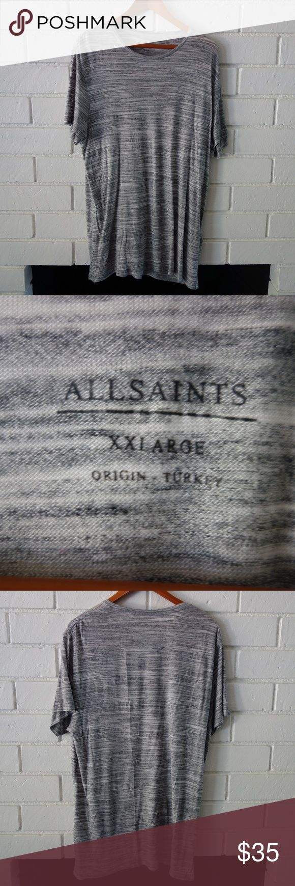 """All Saints Long Line Tee Allsaints Short Sleeve Tee Great condition. 8/10. One small snag on back and small opening along front seam of right sleeve, shown in pictures. Easily fixed. Faded black, grey and white small stripe-like pattern makes this tee easy to layer and wear. Soft viscose and polyester blend holds it's shape and drapes nicely. Usually wear an M size. Looks great.  Measurements flat: 10"""" neck 9"""" sleeve 23"""" armpit to armpit 27"""" front neck to hem Look at pictures and ask…"""