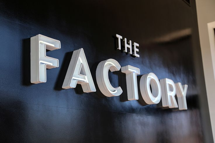 Logotype and signage for fashion store The Factory by graphic design studio Ghost