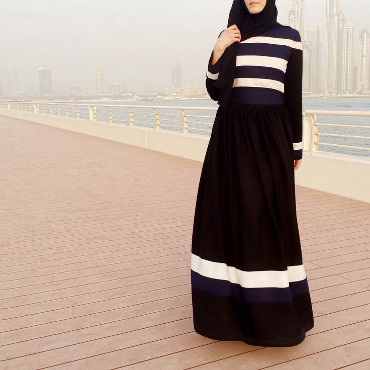 Modest cut and winning color combination - navy, black and white
