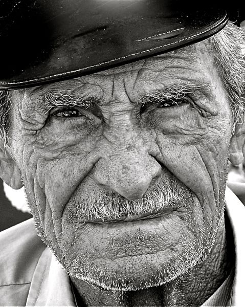 Love the 'life' that shows on the older Greek people (usually the islanders) So many stories and history they've been through. (Old man in Antiparos island)