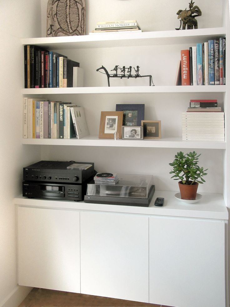 Alcove Storage Idea - Plain white I like the bottom handless doors but would like uneven open boxes set above then another handless cupboard at the top