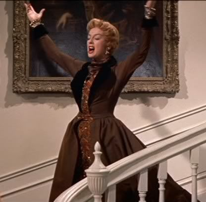 """""""Auntie Mame: Oh, Agnes! Here you've been taking my dictations for weeks and you haven't gotten the message of my book: live!  Agnes Gooch: Live?  Auntie Mame: Yes! Live! Life's a banquet and most poor suckers are starving to death!"""""""