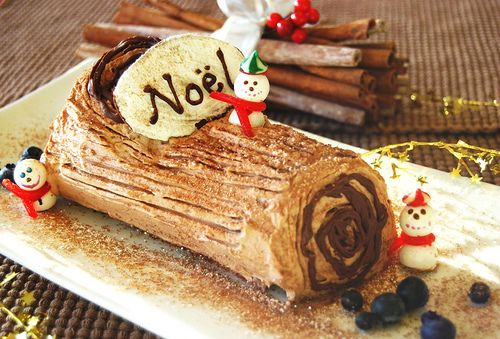 Bûche de Noël is a traditional dessert served near Christmas in France and several other francophone countries and former French colonies. It can be considered a type of sweet roulade.The traditional bûche is made from a Génoise or other sponge cake, generally baked in a large, shallow Swiss roll pan, frosted, rolled to form a cylinder, and frosted again on the outside. The most common combination is a basic yellow sponge cake, frosted and filled with chocolate buttercream