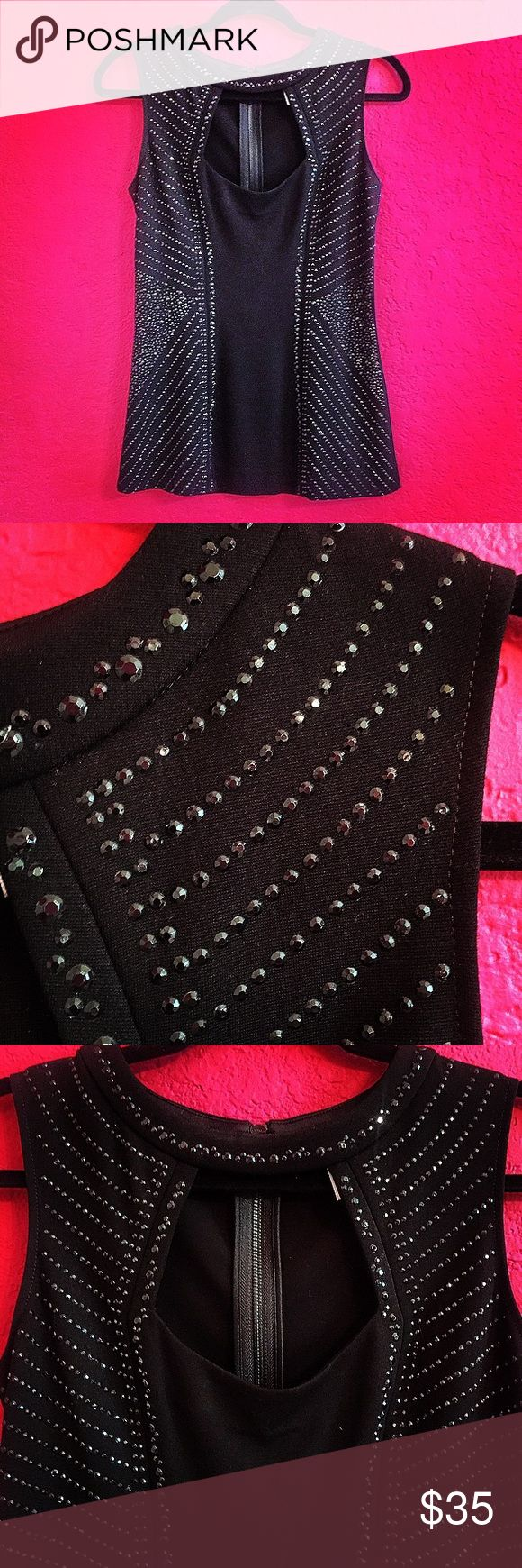 Embellished, Cutout, Sleeveless Blouse by Cache This embellished, cutout, sleeveless blouse by Cache can be worn to formal occasions or easily converted for a dressy casual event when paired with a cute pair of jeans. Here are the deets:  Size Small - Fits True to Size Black Fabric Black Beading Embellishment  Sleeveless Cutout on Chest Gently Worn (Worn 1x ONLY) No Known or Visible Flaws Back Zipper Stretchy Material Cache Tops Blouses
