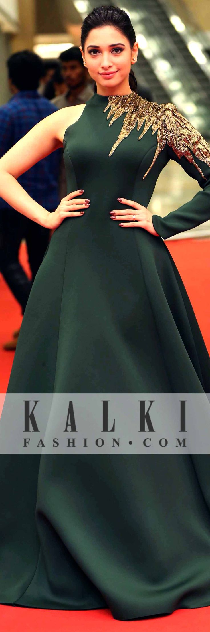 Dazzling in a bottle green gown with embellishing golden work, she had all eyes on her as she walked down the ramp.