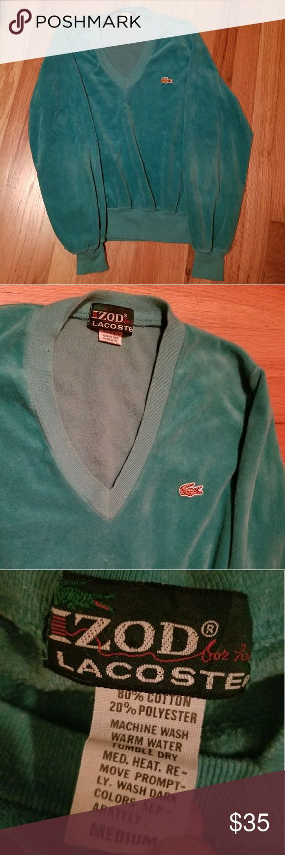 Vintage Lacoste velour cropped sweatshirt Be comfy, cozy, and stylish in this cropped turquoise velour sweatshirt from Lacoste.  Slight V neck.   Labeled a medium but fits like a small.   Small signs of wear along neckline due to being vintage. Lacoste Sweaters V-Necks