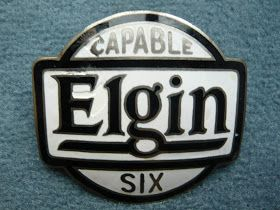 This is the second of 4 ELGIN emblems.  They sold 1,316 cars in 1918.   There is a makers mark on the back side of the curved emblem: THE...