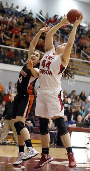 Fort Gibson's Susie Kilpatrick and Cushing's Mariah Burris fight for a rebound during the 4A girls high school basketball game in the semifinals of the state tournament between Cushing and Fort Gibson at Southern Nazarene University in Oklahoma City, Friday, March 8, 2013. Photo by Sarah Phipps, The Oklahoman