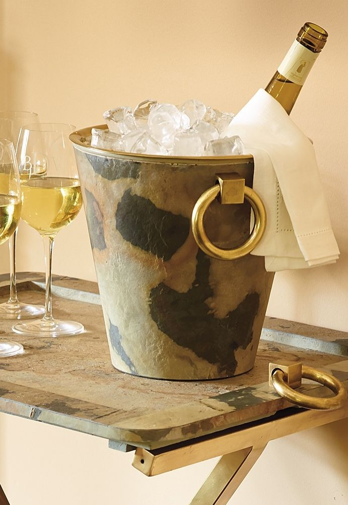 A bottle of fine French champagne is a true work of art, and deserves to be showcased and chilled in equally stunning ice bucket. This handsome piece features a beautiful, hand-applied natural stone veneer and an antiqued, brass finished interior tub. The double-walled construction prevents sweating while keeping your beverage of choice chilled to the perfect degree.
