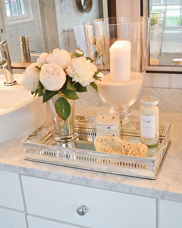 If you have the counter space, a tray to put your hand soap, hand lotion, hand towels, and candles adds so much beauty in such a small way. Details, details, details ... ... #tray #mirrored #candles #flowers #bathroom #bathroominspo #inspo #inspiration #home #homedecor #decor #design #homedesign #homedesigns #designs #instahome #instadecor #instastyle #instainteriors #interior #interiordecor #interiordesign #interiordecorator #interiordecorating