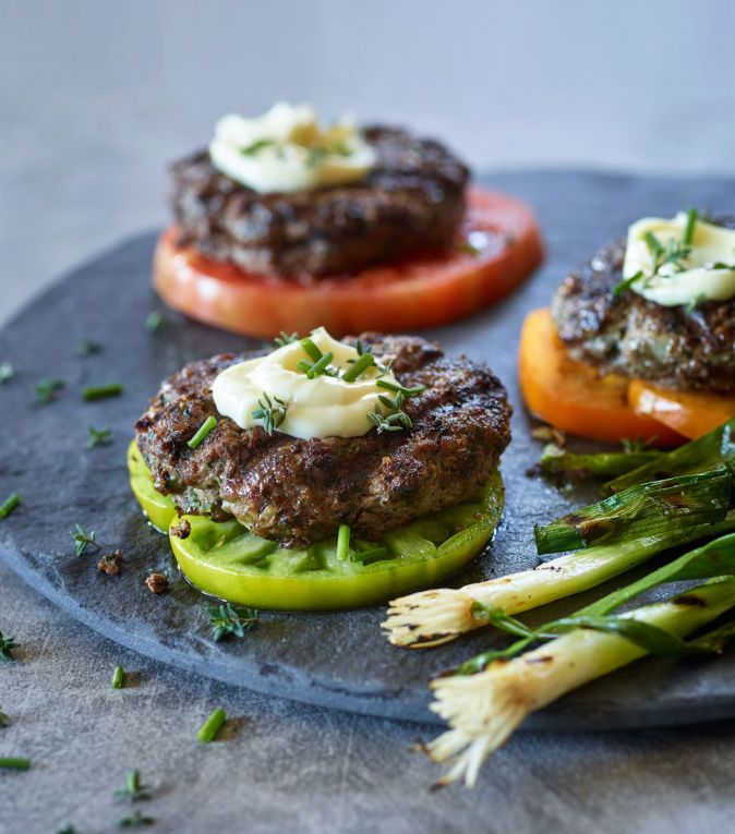 Mediterranean Bison Burgers with Grilled Green Onions and Ripe Tomatoes Recipe | Amazing Wellness Magazine | The Vitamin Shoppe