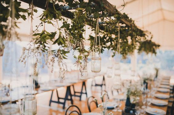 leaves on hanging ladder with hanging vases