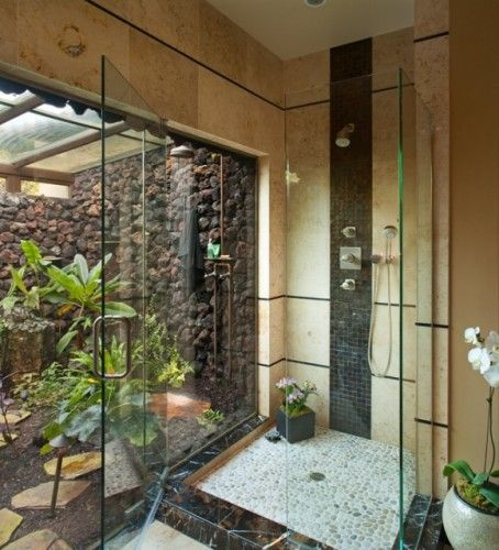 indoor-outdoor dueling showers....there better be a pool oft in the distance.  if there wasn't a pool I'd still be happy!  Riverstones really make the floor pop!