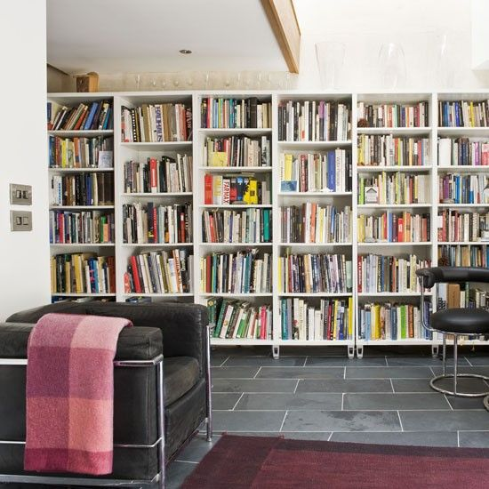 Modern Lateral Bookshelves Let A Book Collection Take Centre Stage By Creating Wall