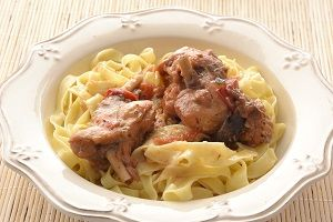 Rabbit meat with lemon sauce and Cretan pasta