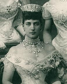 The Russian Kokoshnik Tiara, presented to the Princess of Wales on her Silver Wedding Anniversary in 1888 by Lady Salisbury on behalf of 365 peeresses of the United Kingdom. The tiara was made by Garrard Jewellers and supervised by Lady Salisbury. It is made up of 61 platinum bars and encrusted with 488 diamonds, the largest of which being 3.25 carats each.