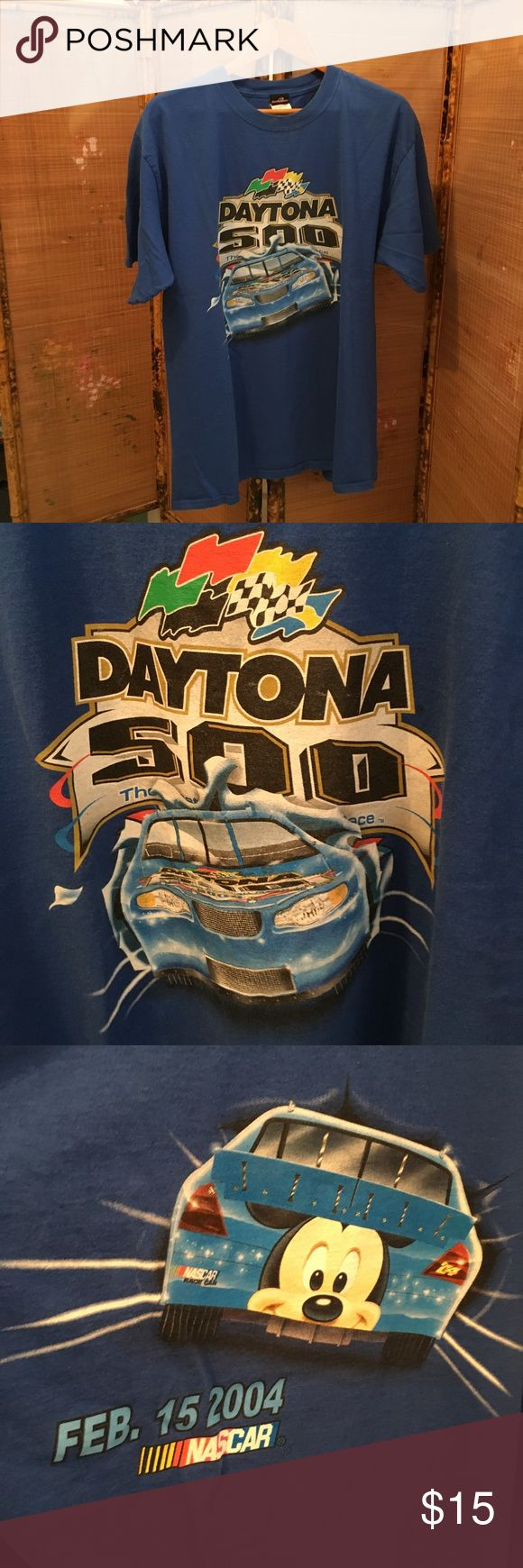 NASCAR 2004 short sleeve tee shirt GUC NASCAR 100% cotton blue 2004 Daytona 500 pace car tee shirt. Front has red, yellow, green, black, and checkered flags above blue car. Shirt back is also back of car with Mickey's head, race date of FEB. 15, 2004, and NASCAR logo. All items come from a smoke free home. Measurements available upon request. All questions are welcome. Daytona Shirts Tees - Short Sleeve