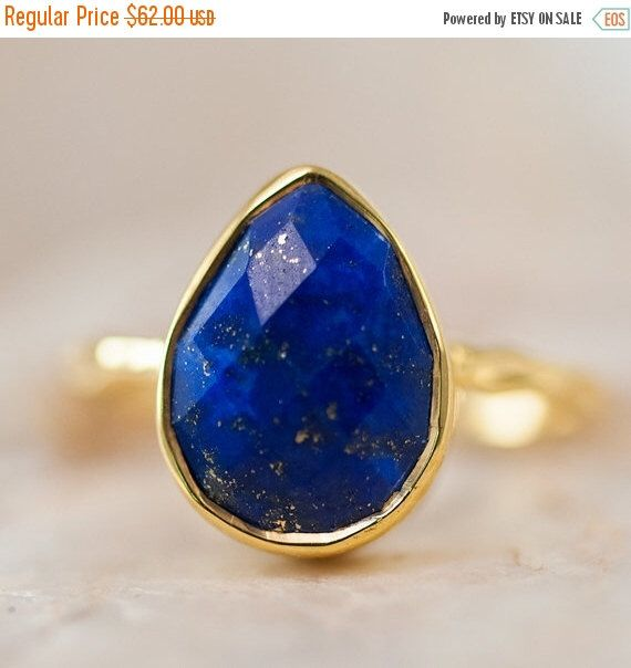 SALE - Blue Lapis Lazuli Ring Gold - September Birthstone Ring - Solitaire Gemstone Ring - Stacking Ring - Gold Ring - Tear Drop Ring by delezhen on Etsy https://www.etsy.com/listing/121269014/sale-blue-lapis-lazuli-ring-gold