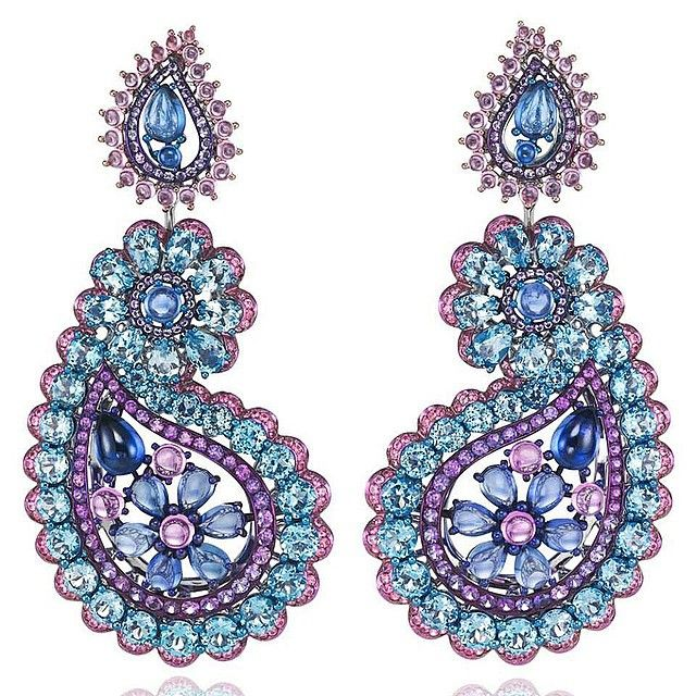 Earrings by CHOPARD. Platinum, blue and rose sapphire, topaz, amethysts.