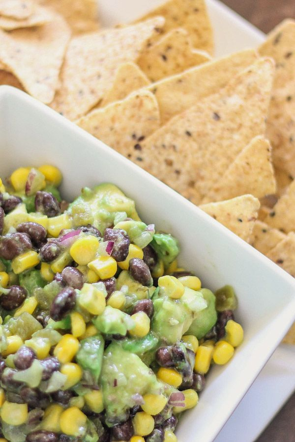 This avocado dip is healthy as it is tasty. You'll love the fresh mix of avocado, black beans, and corn.