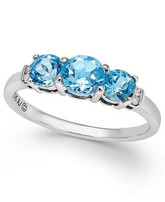 Like the idea of using your husbands birth stone as an anniversary ring. Blue Topaz (1-1/4 ct. t.w.) and Diamond Accent Three-Stone Ring in 10k White Gold
