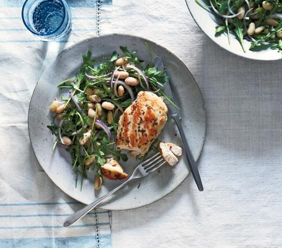 Rosemary Chicken With Arugula and White Beans recipe: You can marinate the chicken and prepare the salad up to 12 hours in advance; just cook the chicken and toss the greens with the dressing before serving.