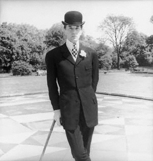 "Neil ""Bunny"" Roger (June 9, 1911-April 27, 1997) was an English couturier, war hero, and dandy. Fighting for the British Rifle Brigade during World War 2, he went to battle wearing a chiffon scarf and brandishing a copy of Vogue. Once, when his sergeant asked him what should be done about the advancing enemy troops, Roger, who liked to wear rouge even with his khakis, replied, ""When in doubt, powder heavily."""