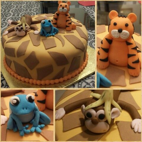 Safari  cake with a monkey tiger and frog.