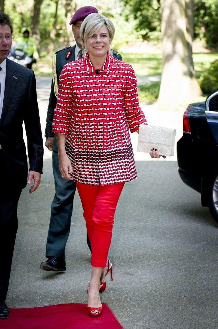 Princess Laurentien in her red outfit with a jacket by Tara Jarmon.