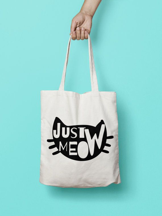 """Cat Tote Bag - Canvas Tote Bag - Printed Tote Bag - Market Bag - Cotton Tote Bag - Large Canvas Tote - Funny Quote Bag - Cat Face Tote Bag Totes are that universal product that everyone needs and uses. A book bag, a grocery bag, or just somewhere to throw in all of those little everyday items. 100% Bull Denim Woven Cotton construction Dimensions: 14 3/8"""" x 14"""" (36.5cm x 35.6cm) Dual handles Fabric weight 11.0 oz/yd² (373 g/m²) Superior screen printing results A cute, all-purpose natural…"""