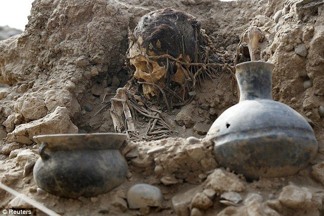 A burial site containing eleven pre-Inca tombs, some dating back more than 1,400 years, has been discovered near a sports centre in Peru. An archaeology team began excavation work at the Huaca Tupac Amaru B site near Peru's national sports village in the capital Lima in December. Yesterday they unveiled their findings so far which include the well-preserved graves containing eleven pre-Hispanic bodies.