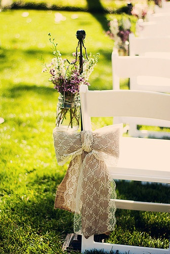 Burlap and Lace Wedding Bows With mason jars filled with flowers to line the aisle- perfect for the rustic romance theme!