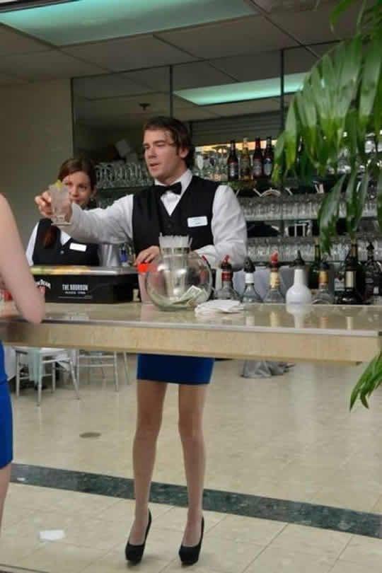 funny odd photos bartender skirt