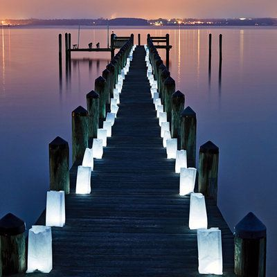 Paper lanterns are easy to assemble and light up a dock, drive- or walkway, or beach path in style.
