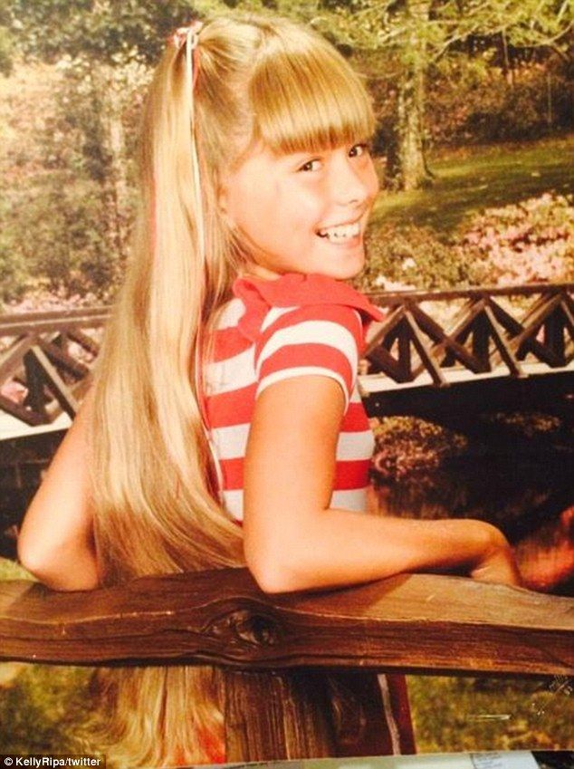 Golden girl: Kelly Ripa shared a childhood photo, showing her long, blonde locks and thick...