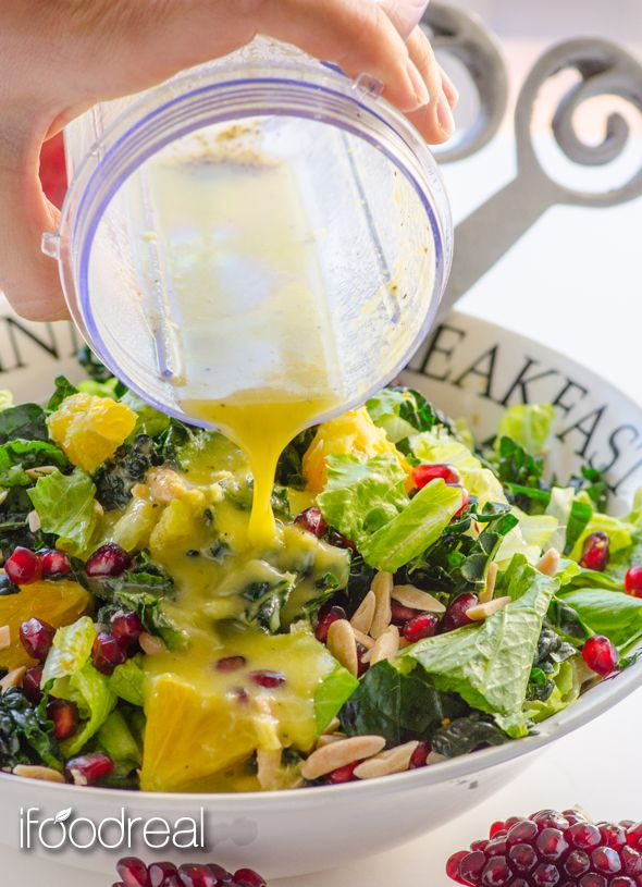 Winter Fruit Kale Salad with Orange Ginger Dressing - Raw kale salad with pomegranate arils, orange slices and toasted slivered almonds, drowning in guilt-free scrumptious Orange Ginger dressing.