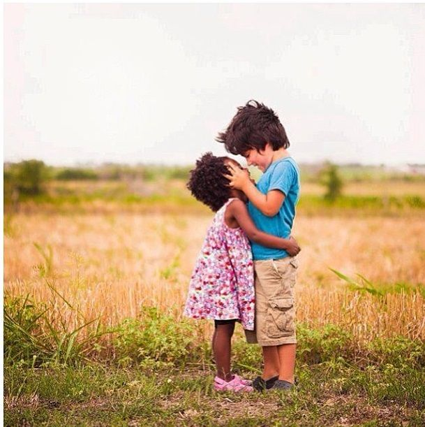 I really like this pic. They are so cute........proof that negative thoughts of other races are learned.