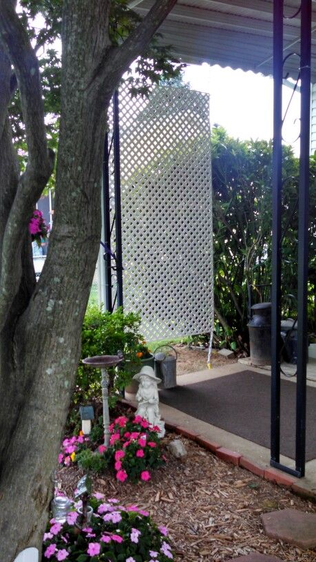 Outdoor lattice privacy screen hang a sheet of vinyl 1 for Hanging patio privacy screen