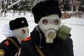 """Gas masks and hair bows:  They are """"the Little Spies of Putin"""" — or at least that's what a French publication called them"""