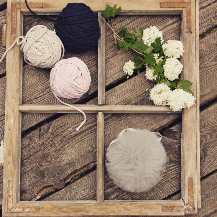 Vintage window and our handmade pompon in. So simple, so beautiful