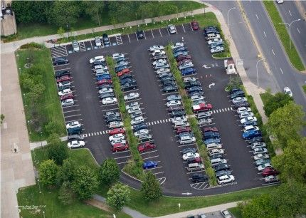 Completed in 2010, the stormwater retrofit project at the County Parking Lot at S. Townsend Street involved repaving the lot with new asphalt pavement, restriping lanes, and installing two 8-foot wide tree infiltration trenches.